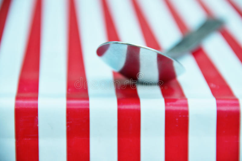 Stainless Spoon Reflection. Stainless Spoon with Stripped Background Reflection stock photo