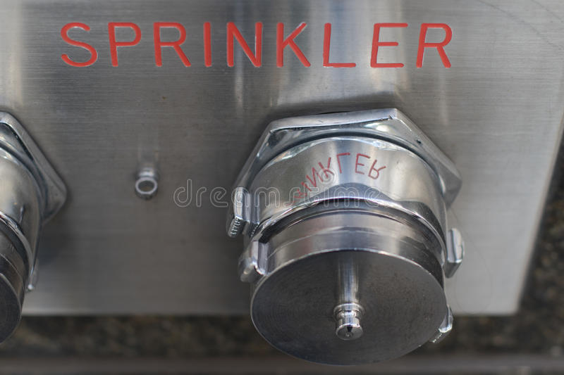 Stainless steel auto sprinkler system covers and plate. S outside of hirise building . part of fire alarm suppression system stock photos