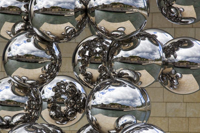 Stainless steel balls cityscape reflection. Reflection of the Bilbao cityscape on several stainless steel balls stock photography