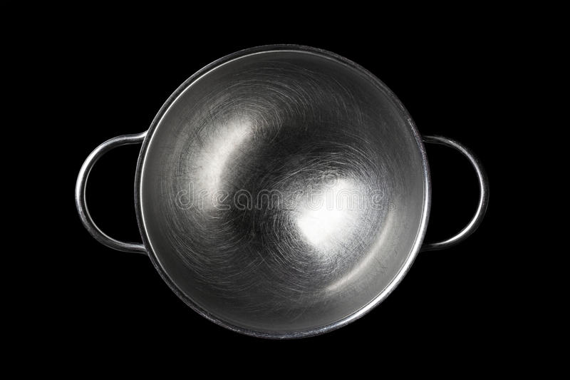 Stainless steel bowl directly from above on black stock photo