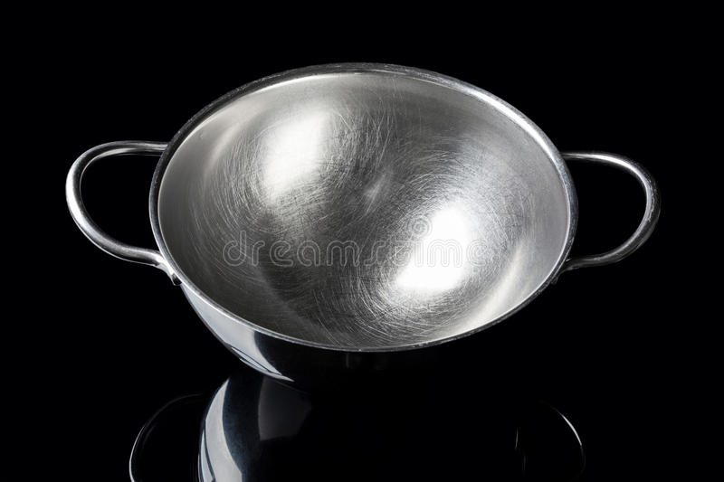 Stainless steel bowl from high angle on black stock images