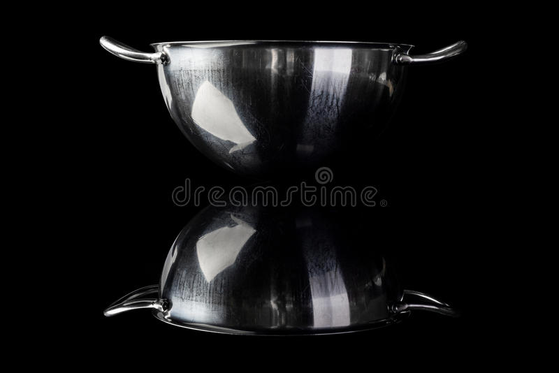 Stainless steel bowl from side on black with reflection stock photos