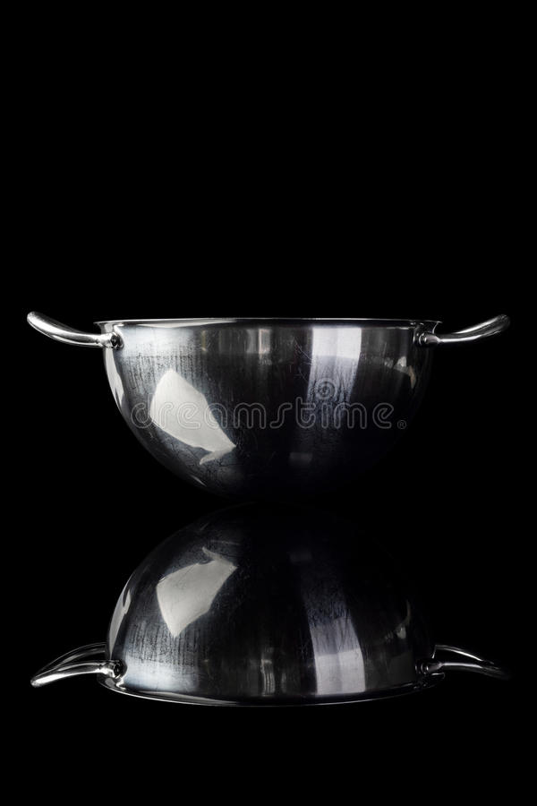 Stainless steel bowl from side on black with reflection vertical royalty free stock photos