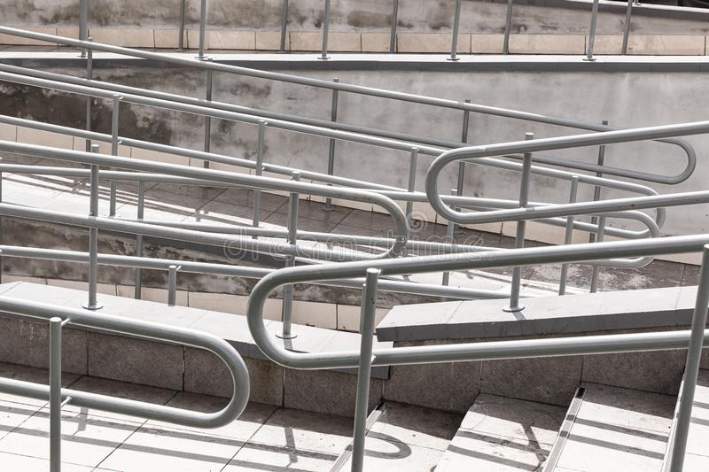 Stainless steel handrails for ramps for the disabled, handrails for ramps and handrails for the disabled.  royalty free stock images
