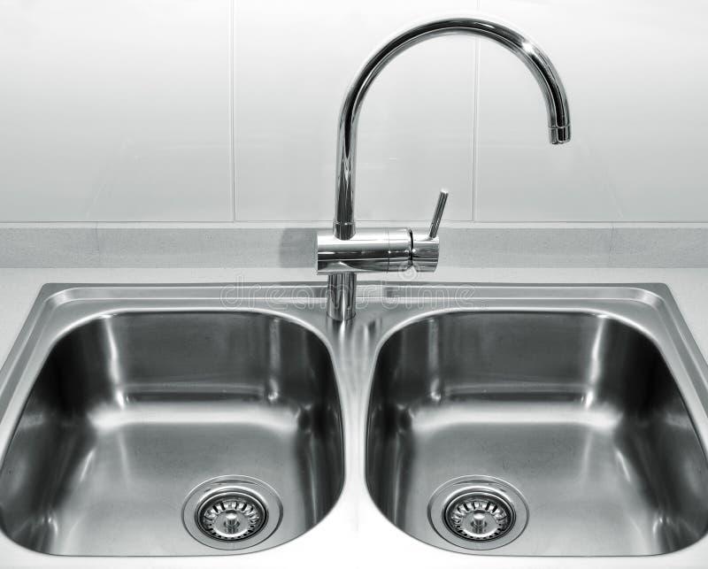 Stainless steel kitchen sink stock image