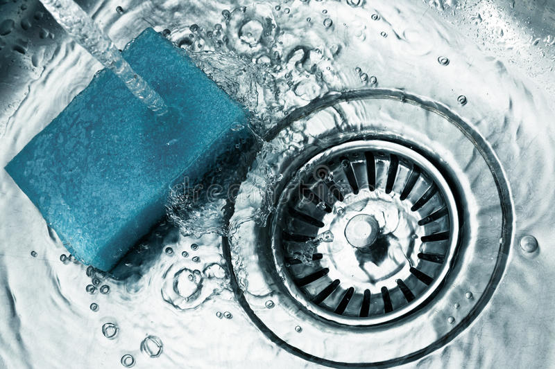 A stainless steel kitchen sink drain stock image