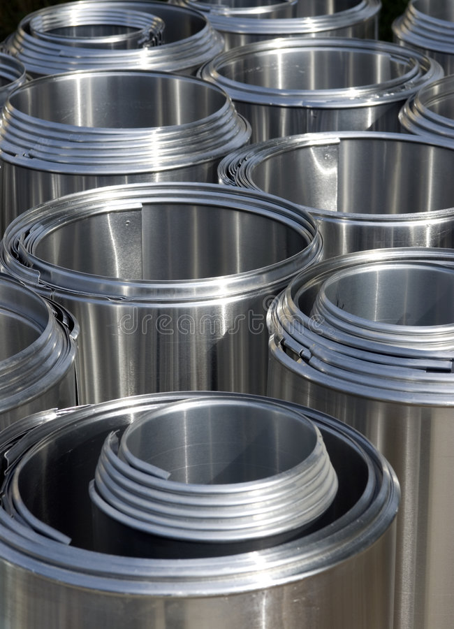 Stainless Steel Pipe Insulation Covers. Stainless steel covers for pipe insulation lay in a construction site (background patterns royalty free stock photography