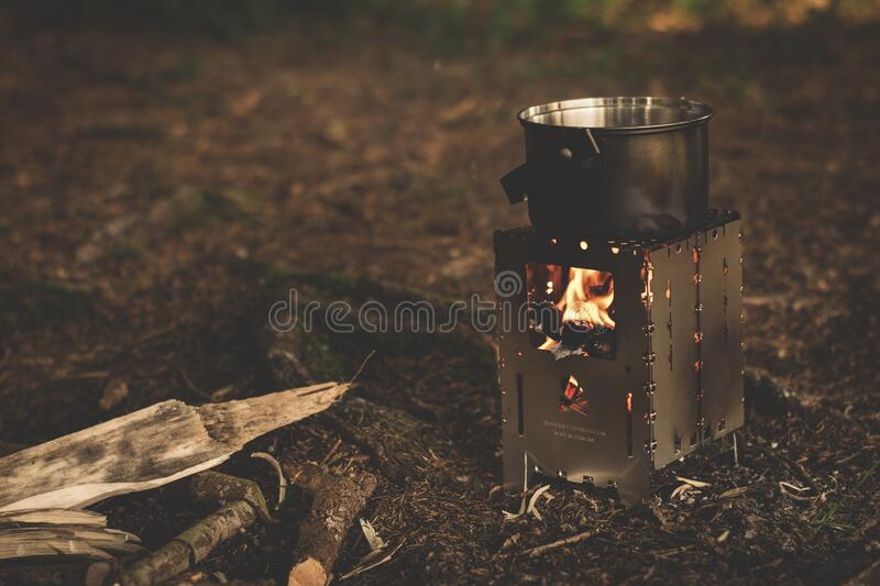 Stainless Steel Pot On Brown Wood Stove Outside During Night Time Free Public Domain Cc0 Image