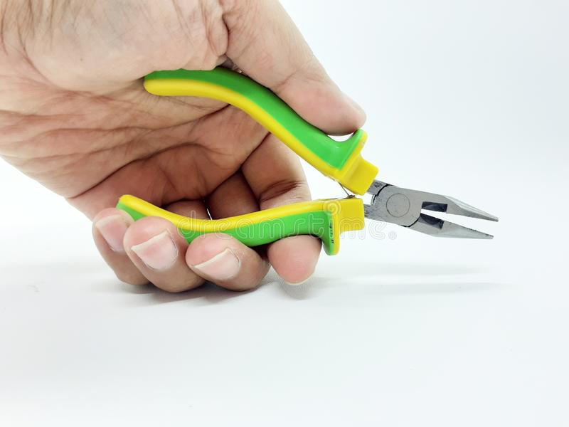 Stainless Steel Rubber Hand Holding Pliers in White Isolated background 01 stock photography