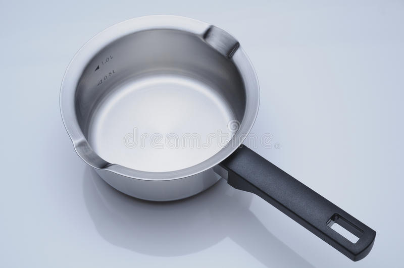 Stainless steel saucepan. High-angle view of long handle stainless steel saucepan.(Capacity:1.6L, Width:16cm royalty free stock images