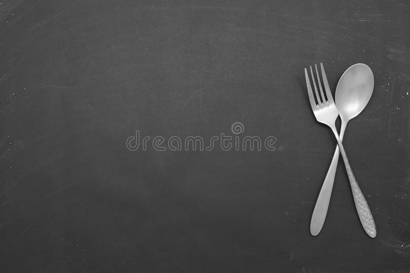 Stainless steel spoon on black background. Stainless steel spoon on black background stock images