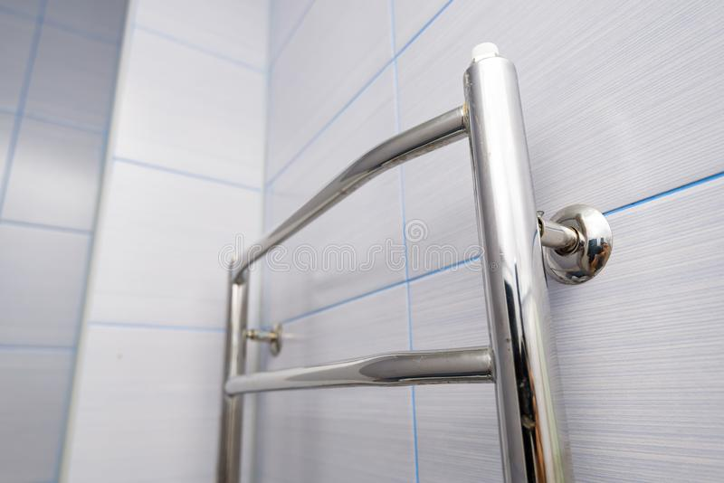 Stainless steel towel hanger on wall in bathroom royalty free stock photo