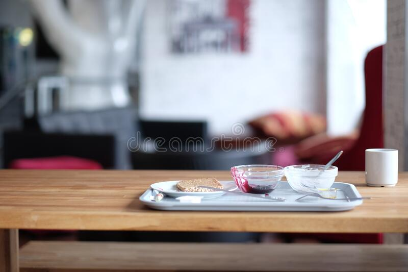 Stainless Steel Tray on Brown Wooden Table royalty free stock photos