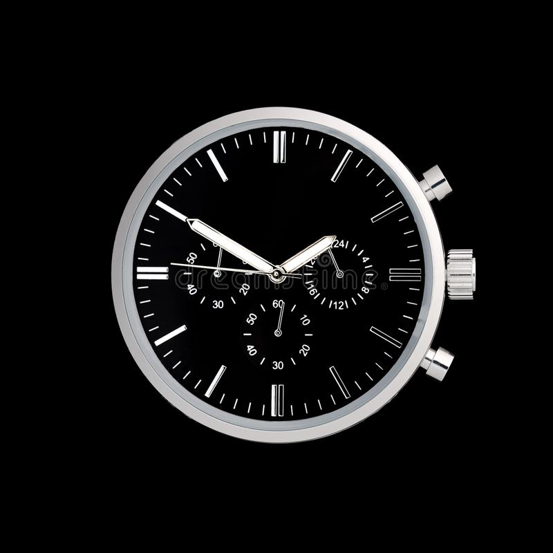 Stainless steel watch front with black dial stock photo