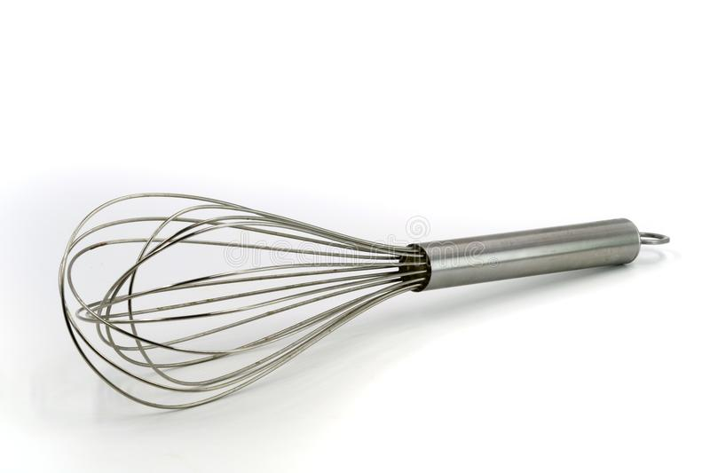 Stainless steel whisk isolated on white. Background royalty free stock photos