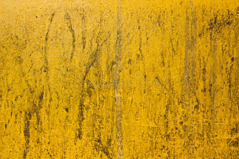 Stains on the surface, a yellow wall. stock photos