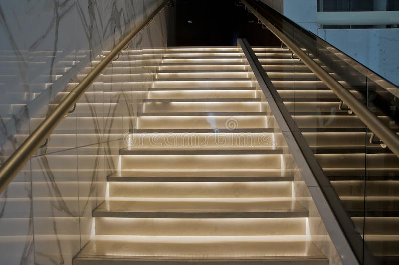 Bright stairs in the hotel. Stair case in the modern hotel interior royalty free stock images