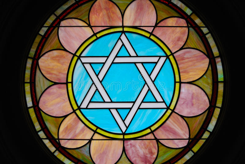 Stair of David Stain Glass. Colorful stain glass image of a Star of David in a synagogue stock photo