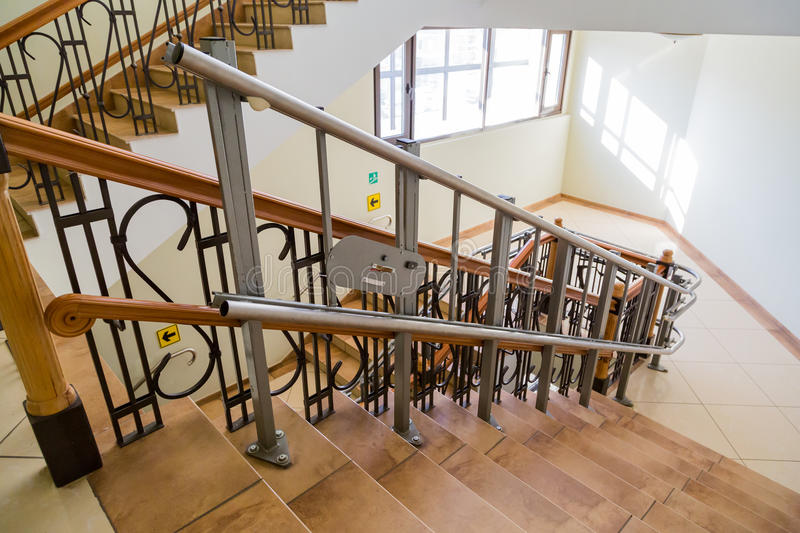 Stair lift for the disabled. Stairs of public building.  stock images