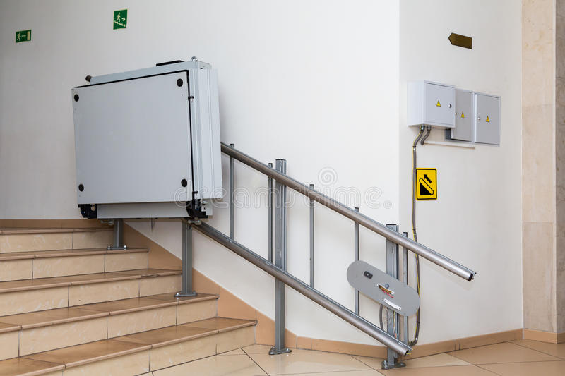 Stair lift for the disabled. Stairs of public building.  royalty free stock photography