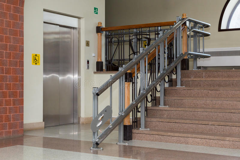 Stair lift for the disabled. Stairs of public building.  royalty free stock photos