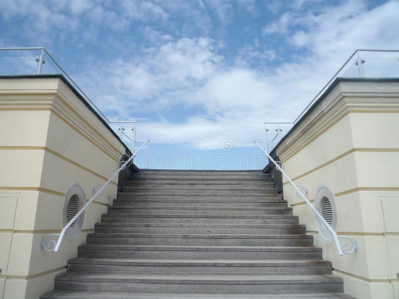 Stair to success concept: elegant stairs with a blue sky on the top and copy space for your text royalty free stock photography