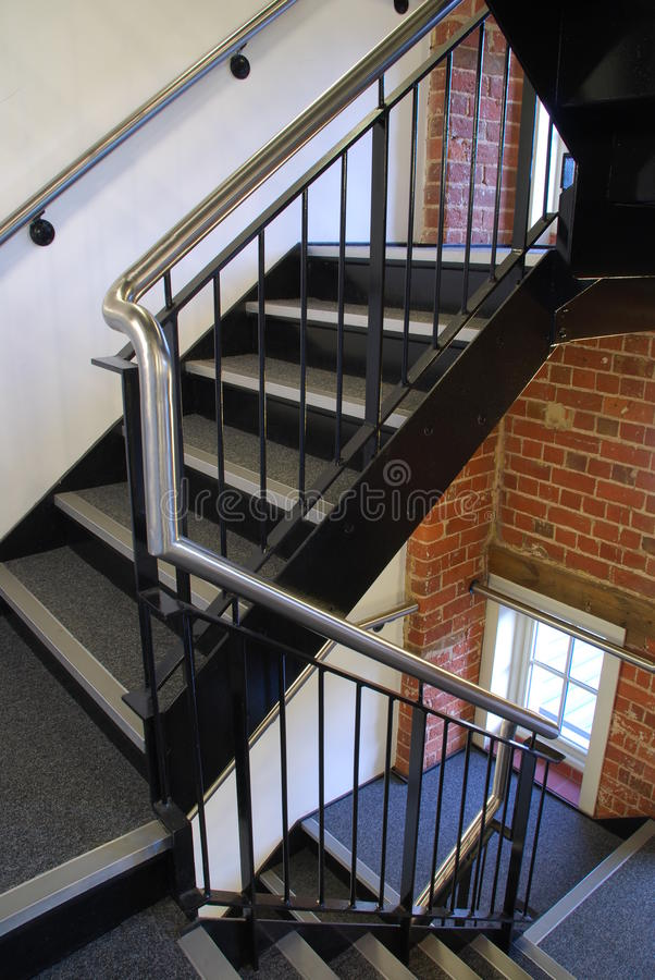 Staircase. Vintage staircase on a antique residential building with brick wall stones as a strong architectural detail stock images