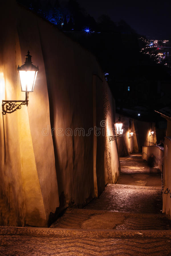 Staircase alley with lanterns in Prague at night royalty free stock images