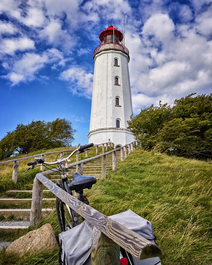 Staircase with bike to the lighthouse on the island Hiddensee. Mecklenburg-Vorpommern. Architecture, clouds, blue, building, europe, landscape, leuchtturm royalty free stock photos
