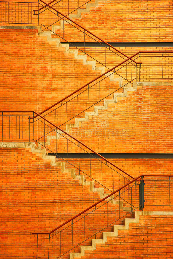 Staircase. The staircase and brick brown wall texture royalty free stock photos