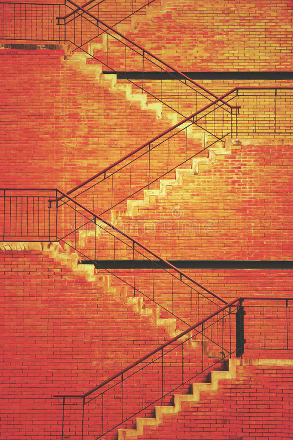Staircase. And brick brown wall texture royalty free stock photos