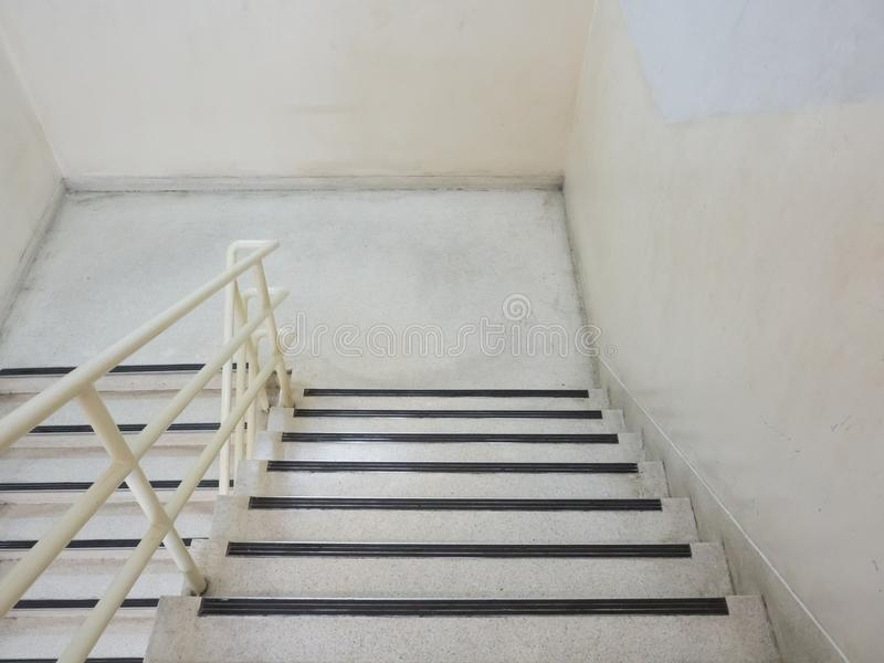 Staircase fire exit down in the building stock image
