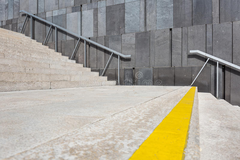 Staircase in front of concrete wall stock photos