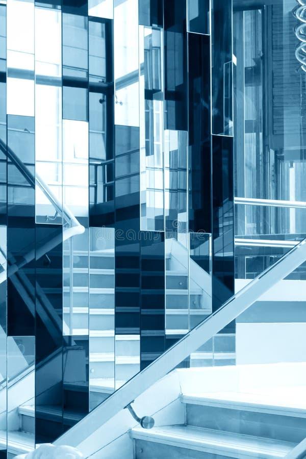 Staircase with glass wall. Staircase with glass collage wall royalty free stock image