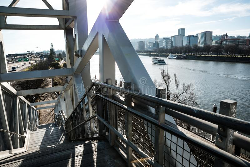 Staircase going down to the Eastbank Esplanade the Willamette River and the downtown Skyline in Portland, Oregon. December 2017. With it`s entrance on the royalty free stock photo