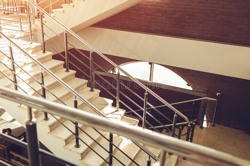 Staircase in modern buisness center building. Emergency evacuation exit. Stairs in shopping center. White ladder stock photo