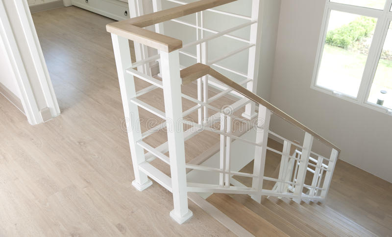 Staircase in modern house. Wooden staircase with iron banister in modern house stock image