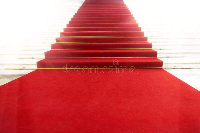 Staircase with red carpet, illuminated by light. Image on the staircase with red carpet, illuminated by light royalty free stock images