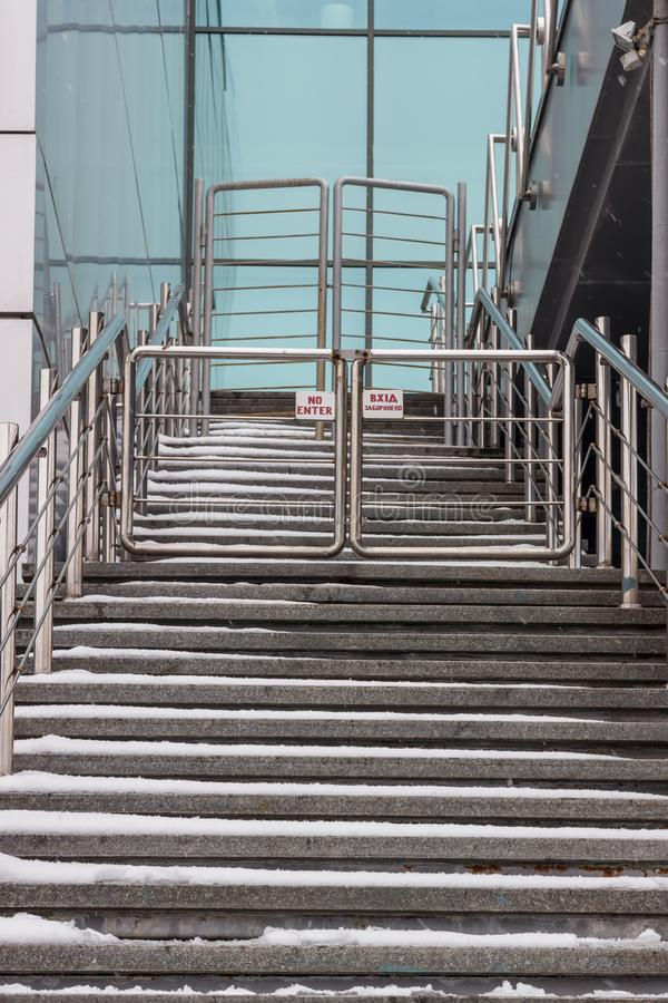 A staircase rising in a modern office building with metal rails on the sides.  royalty free stock images