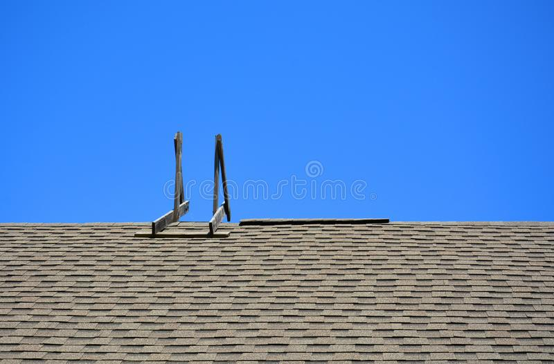 Staircase on the roof against the blue sky. Conquering heights royalty free stock photos