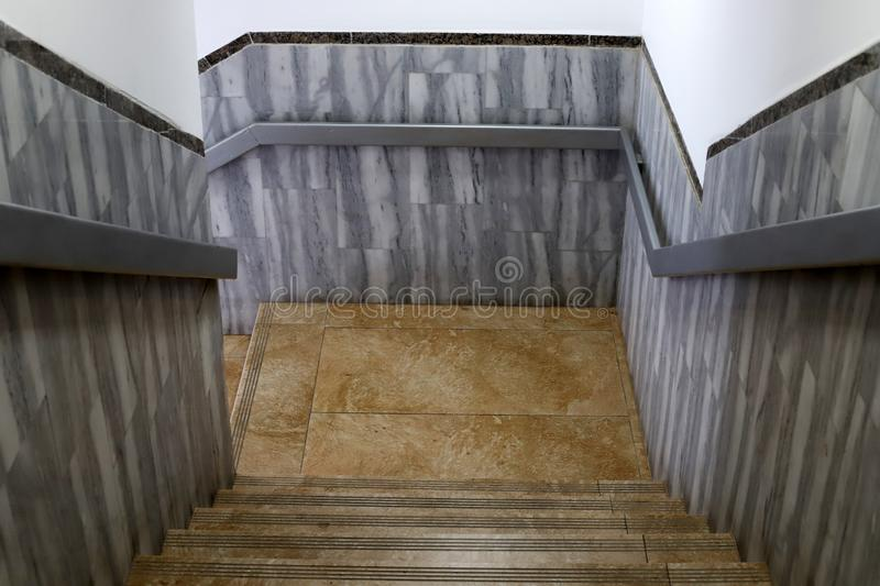 A staircase is a structure in the form of a series of steps for ascent and descent. A staircase is part of the structure of a building and structure in the form royalty free stock photos