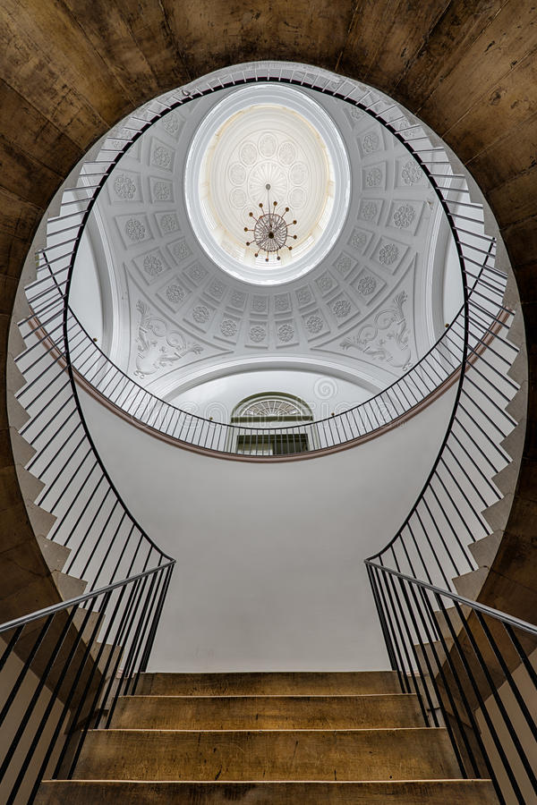 Staircase under cupola. A self-supporting marble staircase splits to become double circular stairs in the rotunda of the Old Kentucky State Capitol building in stock photo