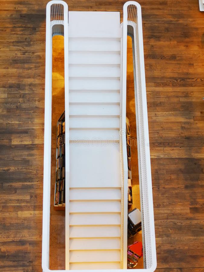 The staircase viewed from top. With railing - hardwood flooring down stock images