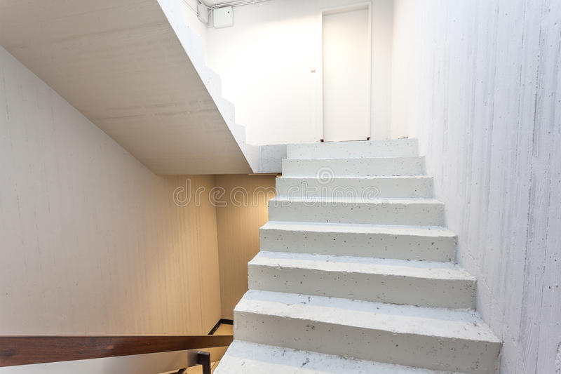 Staircase. Whit white stone of steps down stock photography