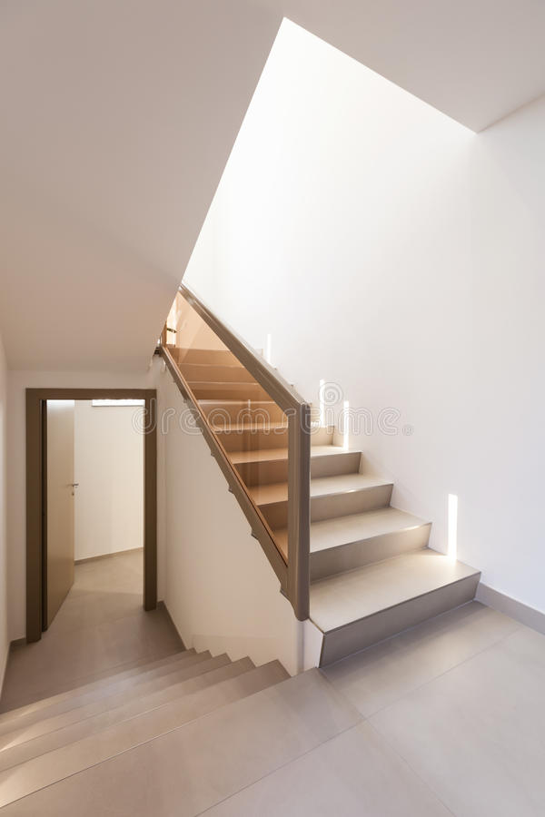 Staircase and white walls. Entry of an apartment, staircase and white walls royalty free stock photos