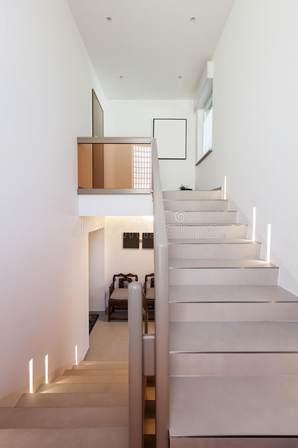 Staircase and white walls. Entry of an apartment, staircase and white walls royalty free stock photo