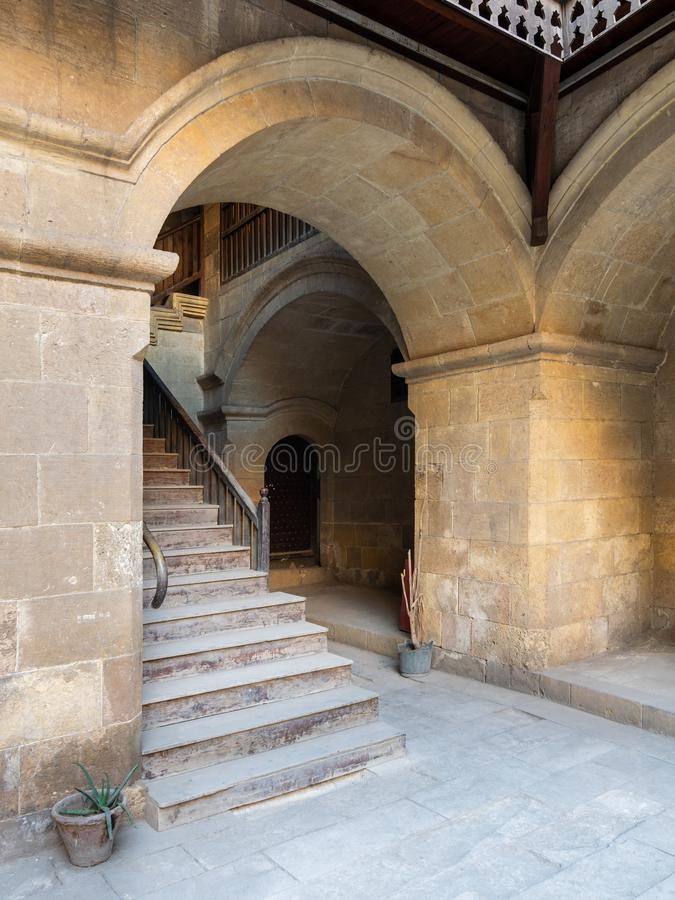 Staircase with wooden balustrade leading to an old abandoned historic building, Cairo, Egypt. Exterior daylight shot of staircase going up leading to Caravansary royalty free stock images