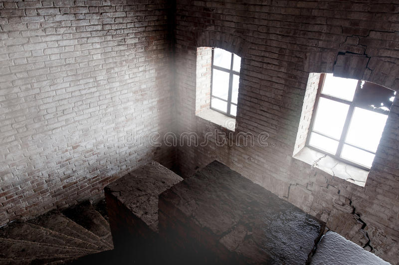 staircases in an abandoned complex with dramatic light royalty free stock image