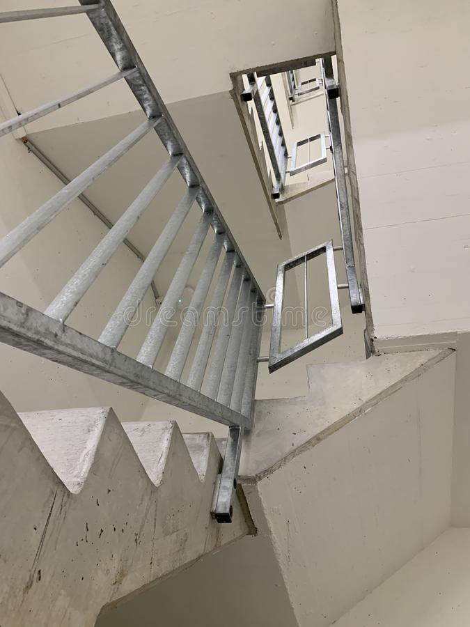 Staircases or stairway in white painted concrete with metal railings with detail in Central Library Zurich, Switzerland stock photos