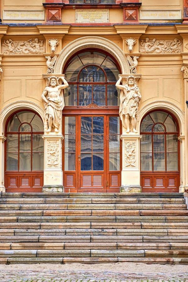 Stairs and beautiful entrance door between pillars with sculptures. Schwerin, Mecklenburg-Vorpommern stock images